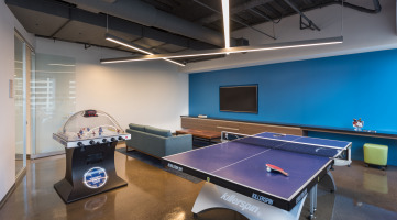 Ping pong table featured in the lounge space of a commercial office building
