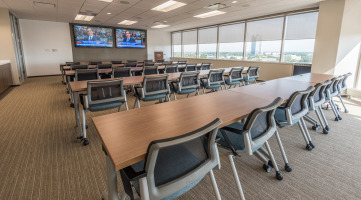 Tables, chairs, and technology for a training room