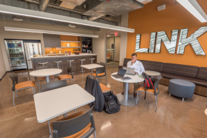 Cafeteria space in the workplace with company branding