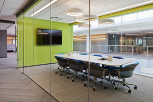 Conference room with table, chairs, and integrated technology