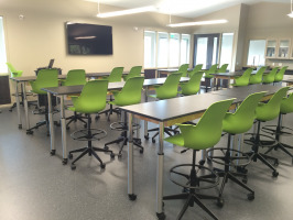 Integrated technology with chairs and tables in a classroom
